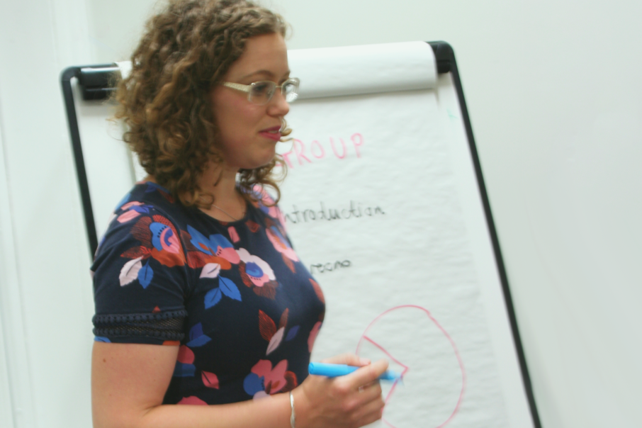 Image of female presenting, with flipchart and pen - About Veritau