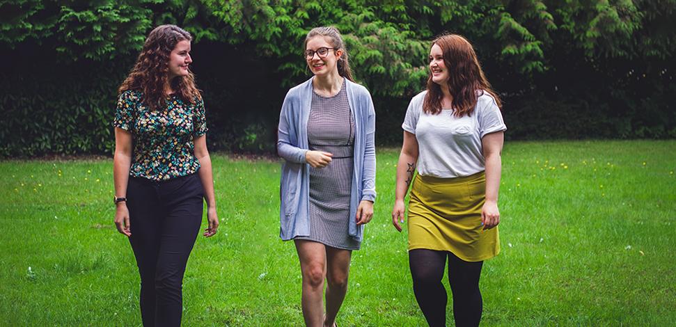 Image of three Veritau female staff outdoors, smiling - Corporate Social Responsibility - Veritau