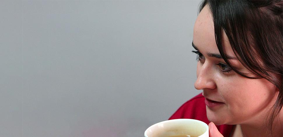 Emergency services assurance Veritau - Image of female staff member drinking tea
