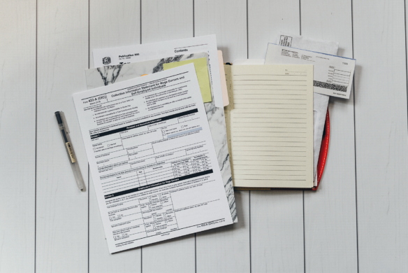 Fraud data match - image of tax bill with pen and notepad