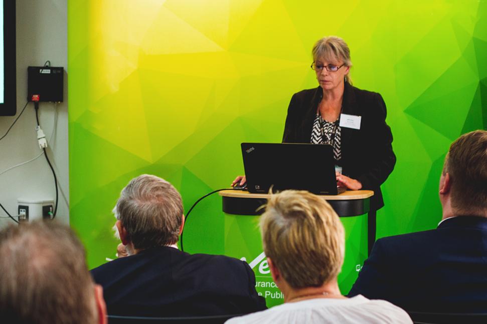 Female staff member presenting at podium - Veritau assurance services