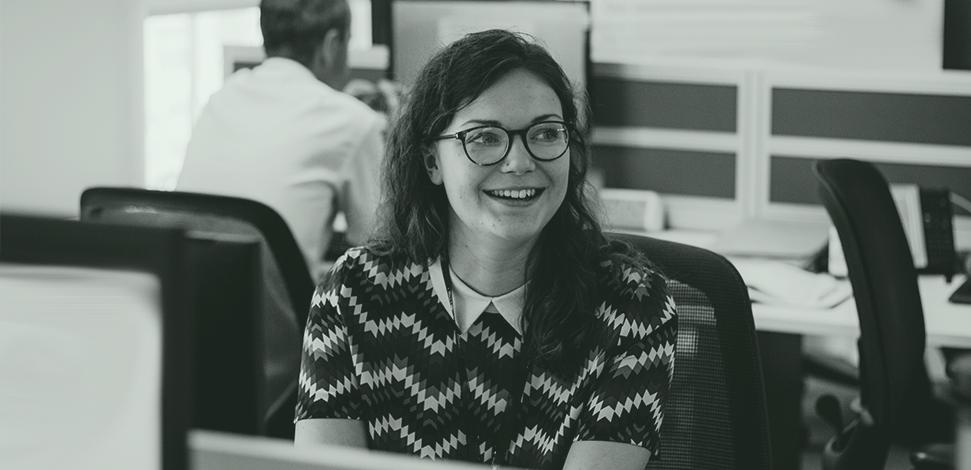 Veritau careers page: Female smiling in office