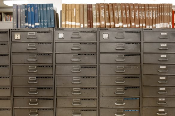 Image of filing cabinet and paper folders - The five whys of information security